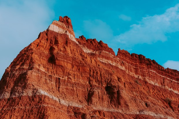 Layers of sedimentary rock on the walls of Palo Duro Canyon State Park in Canyon, Texas. The white lines in the walls of the canyon are formed from minerals of ancient lake beds that evaporated.