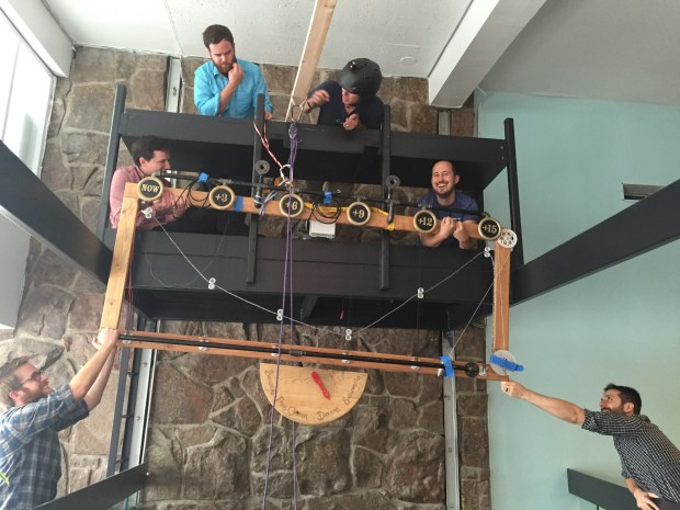 The team at interactive agency Viget in Boulder hoist up the Temperometer onto what used to be DJ booth.