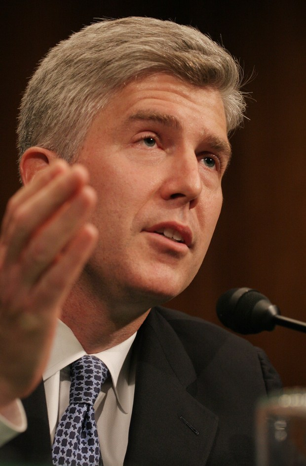 This 2006 file photo shows Neil Gorsuch speaking at his nomination hearing to the United States Court of Appeals for the Tenth Circuit on Capitol Hill in Washington.