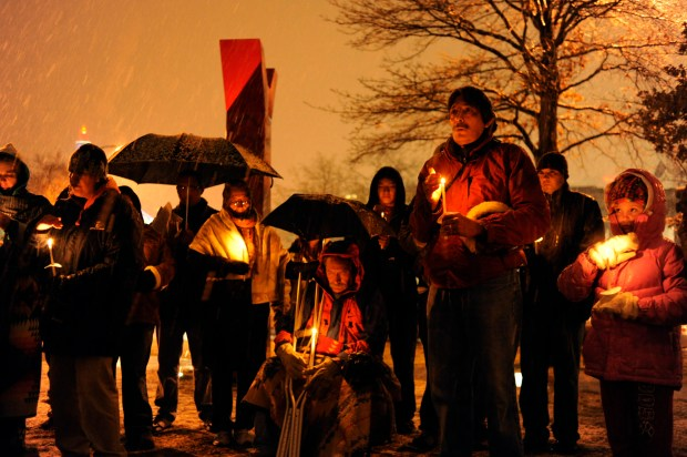 The anniversary of the Sand Creek massacre of native Americans was marked with a candlelight vigil in front of the Denver Art Museum Friday night, Nov. 28, 2008.
