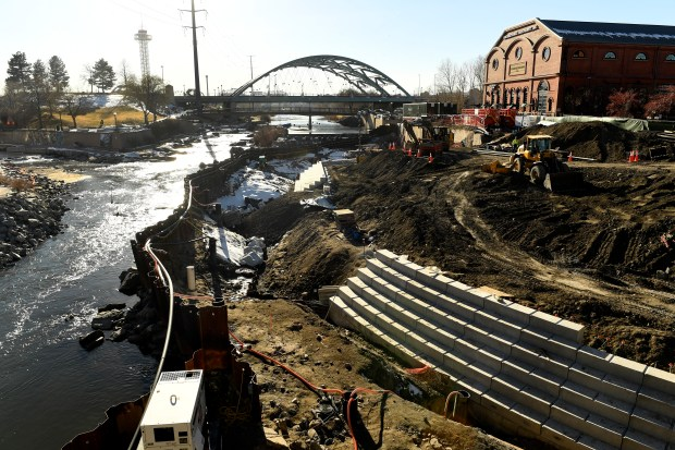 Work continues on the trickier-than-expected project at the new riverfront plaza at Confluence Park on Dec. 29, 2016, in Denver.