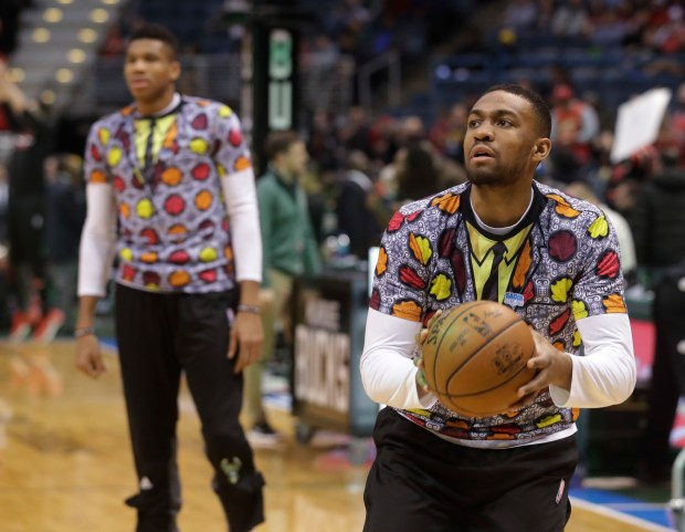 Milwaukee Bucks' Giannis Antetokounmpo and Jabari Parker wear shirts to honor NBA broadcaster Craig Sager