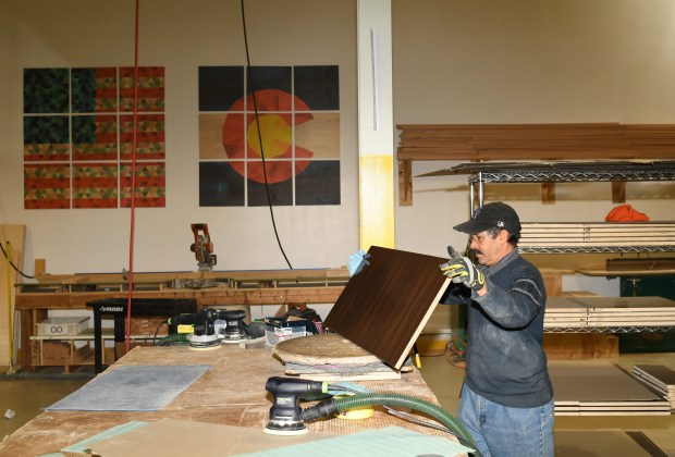 Muhammad Raza works on building home goods at Deny Designs in Englewood, December 01, 2016.