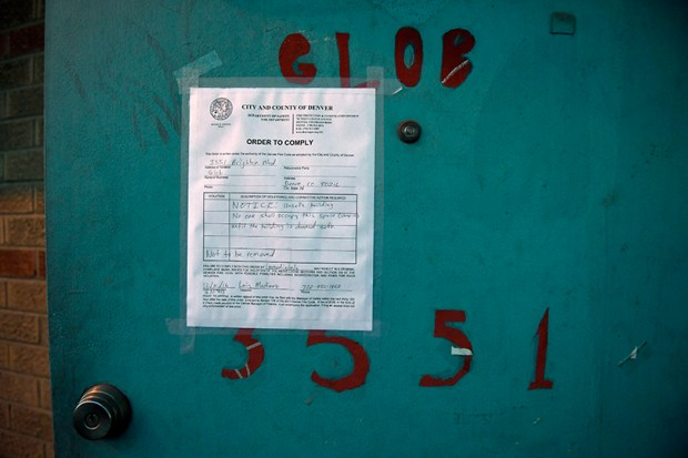 An eviction notice appears on the door of Rhinoceropolis on Dec. 8.