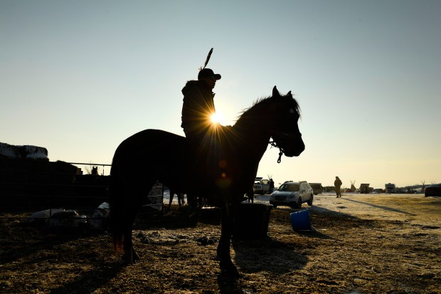 Cape Teal, of the Cheyenne River Sioux nation gets ready to head out for a ride on his horse Sasha at Oceti Sakowin Camp on the edge of the Standing Rock Sioux Reservation on Dec. 3, 2016 outside Cannon Ball, North Dakota.