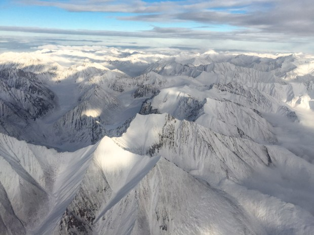 Aerial view of the Brooks Mountain Range en-route to the Northern Slope of Alaska. The Brooks Range is the northernmost mountain range in the United States and is one of Alaska's most remote and untraveled areas.