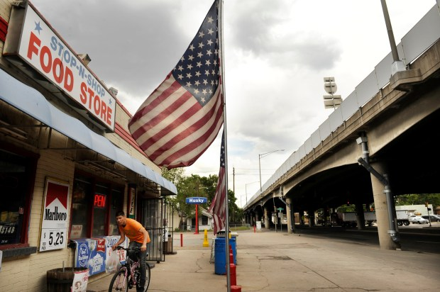 A youth leaves the Stop-N-Shop Food Store in Denver's Elyria-Swansea neighborhood Wednesday, May 16, 2012.