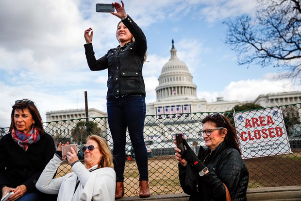 Several women take selfies with the U.S. Capitol in the background Wednesday. They are in Washington, D.C., this week to take part in Saturday's Women's March on Washington.