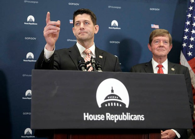 Republican House Speaker Paul Ryan and Rep. Scott Tipton, R-Colo., meet with reporters at the U.S. Capitol on Tuesday. Ryan gave a strong defense of President Donald Trump's refugee and immigration ban to caucus members and said he backs the order.