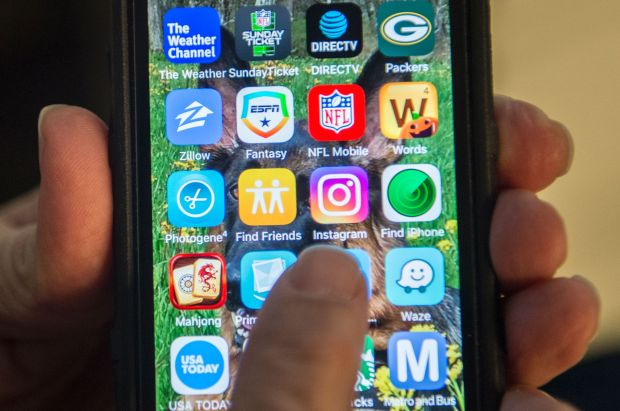 In this November 1, 2016 photo illustration a person points to the new Instagram app on a smartphone.