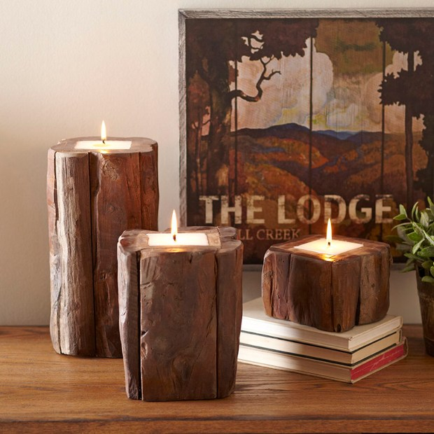 """Teak candleholders. This year's shelter magazines, decor retailers and lifestyle mavens are touting """"hygge,"""" Scandinavian-style coziness, ease, conviviality and a warm glow."""