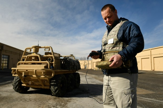 Keith Massie, a mechanical engineer at Lockheed Martin, uses a ruggedized tablet computer that, used with an X-box controller, helps to drive a Squad Mission Support System autonomous vehicle on Jan. 25, 2017 in Littleton.