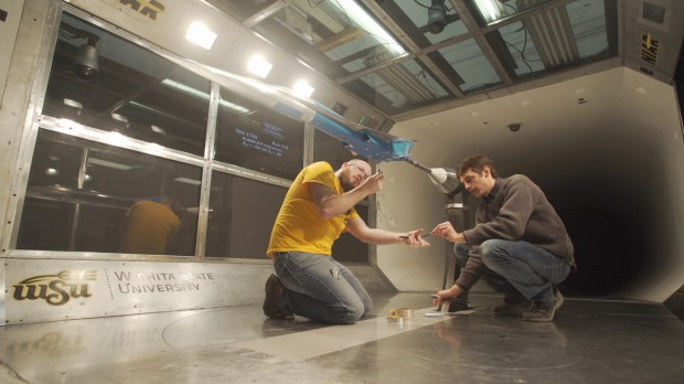 A model simulating Boom Technology's supersonic jet preps for a wind-tunnel test at NIAR at Wichita State University.