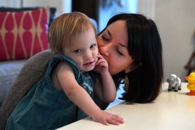 WHEAT RIDGE, COLORADO - JANUARY 26: Megan Wiedel givers her 19 month old daughter Anna a kiss on the cheek during a tutoring session at home on January 26, 2017 in Wheat Ridge, Colorado. Anna was born profoundly deaf as a result of an infection from CMV, a common virus that pregnant women are often under-educated about. It is estimated that 20,000 to 40,000 babies in America are born with congenital CMV each year but arenÕt diagnosed because they appear healthy at birth or doctors mistake their symptoms for other diseases. Anna contracted CMV in-utero from her mother Megan not because the family traveled to another country, but because they have an older toddler. CMV is spread most often through the saliva and urine of children under the age of 3Ñin some studies, it is present in 44 to 100% of toddlers at daycare centers, and they will go on to shed it for two years or longer. (Photo by Helen H. Richardson/The Denver Post)