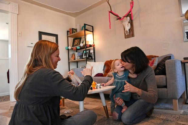 WHEAT RIDGE, COLORADO - JANUARY 26: American Sign Language teacher Lori Fisk, left, works with 19 month old Anna Wiedel, middle, and her mother Megan, right, during a tutoring session at Anna's home on January 26, 2017 in Wheat Ridge, Colorado. Anna was born profoundly deaf as a result of an infection from CMV, a common virus that pregnant women are often under-educated about. It is estimated that, in reality, 20,000 to 40,000 babies in America are born with congenital CMV each year but arenÕt diagnosed because they appear healthy at birth or doctors mistake their symptoms for other diseases. Anna contracted CMV in-utero from her mother Megan not because the family traveled to another country, but because they have a toddler. CMV is spread most often through the saliva and urine of children under the age of 3Ñin some studies, it is present in 44 to 100% of toddlers at daycare centers, and they will go on to shed it for two years or longer. (Photo by Helen H. Richardson/The Denver Post)