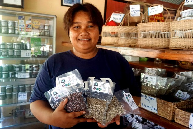 Sorn Sothy poses with some of her products at her plantation in Kampot, Cambodia.