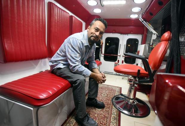 Jesus Bujanda sits in the back of his mobile tattoo removal unit on Tuesday in Greeley. Bujanda, based out of Denver, has been using the unit to help prisoners remove gang tattoos and is hoping to expand the business further within the coming year.