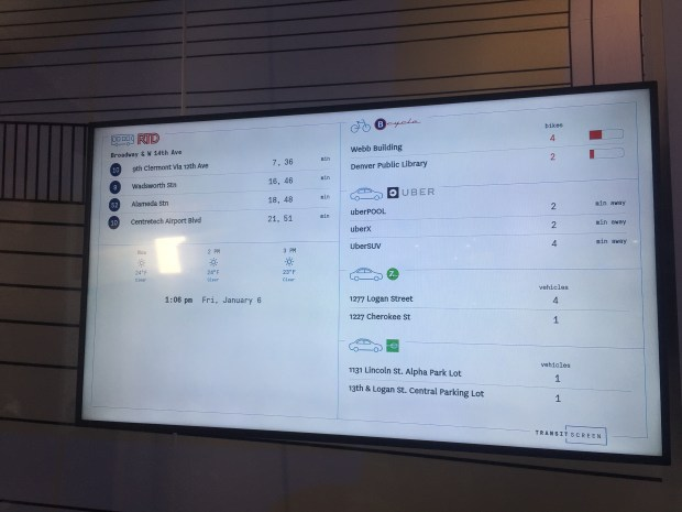 Inside the smart transit shelter at the Panasonic CES 2017 booth, a display shows how long before the next RTD or Uber ride arrives, plus how many bikes are available at nearby B-Cycle locations.