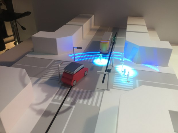 Panasonic demoed V2X technology at its CES 2017 booth in Las Vegas. V2X, or vehicle to everything, is a communication between cars and other cars, road signs or street lights. The objects can let other cars know an accident or traffic congestion is ahead and prepare for a slowdown. Pictured, a light pole communicates with vehicles that pedestrians are walking across the crosswalk. Watch the video for more.