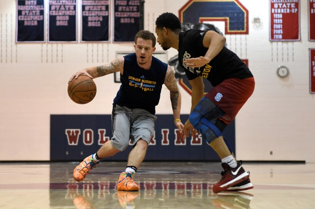 Josh Adams working to drive past ANA Basketball trainer Nick Graham at Chaparral High School. He is recently back following a serious car accident last August and is signed to play professionally in Russia. January 05, 2017 Parker, CO.