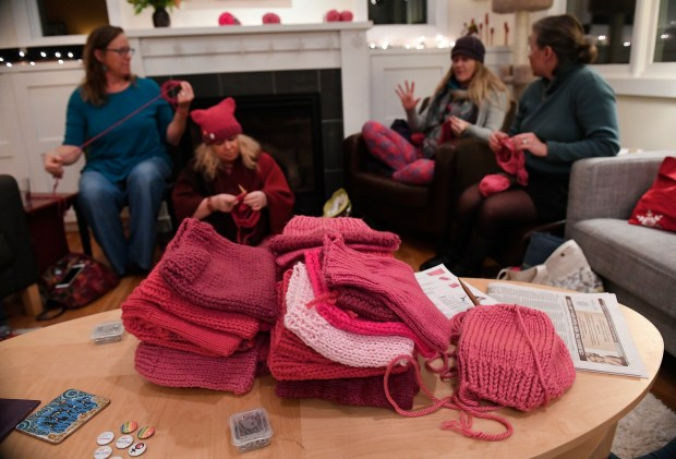 LAFAYETTE, COLORADO - JANUARY 15: From left to right in the back Jen Grant, Julie Piller, Debbie Asmus and Christine Belin all help to knit dozens of pink hats at the home of Jen Grant on January 15, 2017 in Lafayette, Colorado.  The group is called the Pussyhat Project, a nationwide group.  The group aims to provide people participating in the Women's March on Washington D.C., the day after Donald Trumps' inauguration, a means to make a unique collective visual statement which will help activists be better heard and provide people who cannot physically be on the National Mall a way to represent themselves and support women's rights. (Photo by Helen H. Richardson/The Denver Post)