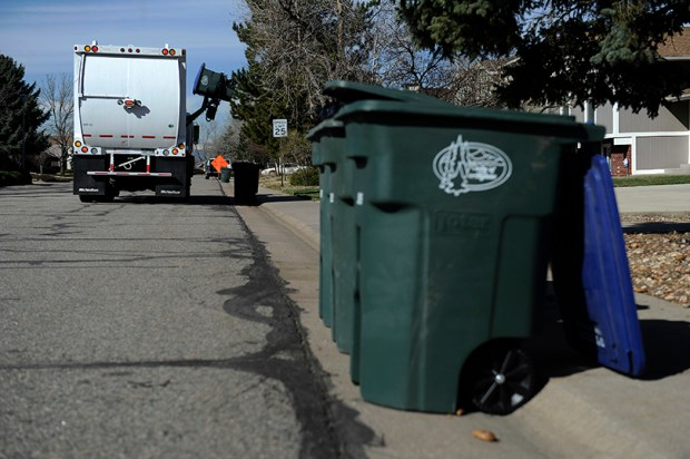 A garbage truck makes stops in Northglenn on April 4, 2013. More than 100 people turned out at Westminster City Hall on Feb. 27, many of them there to condemn a plan that would give the city the responsibility for providing trash and recycling collection to Westminster's 28,000 single-family households.