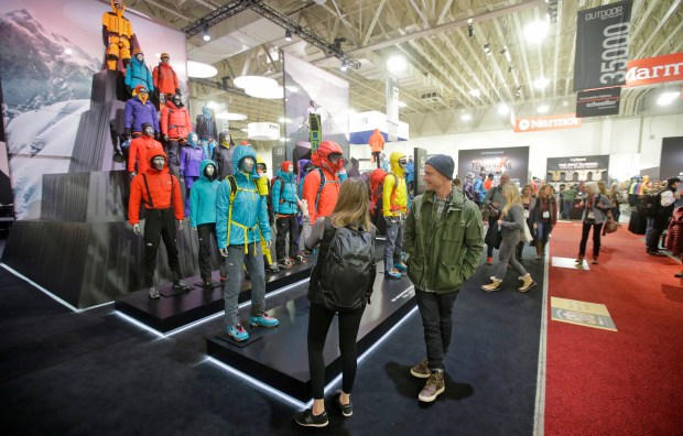 This Jan. 11, 2017, photo, people attend the Outdoor Retailer show at the Salt Palace Convention Center in Salt Lake City.