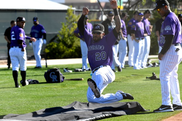 SCOTTSDALE, AZ - FEBRUARY 23: Colorado Rockies shortstop Ian Desmond (20) slides on the sliding pad during Spring Training at Salt River Fields at Talking Stick on February 23, 2017 in Scottsdale, Arizona. (Photo by John Leyba/The Denver Post via Getty Images)