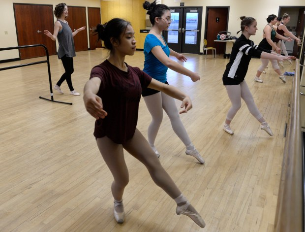 Ballet instructor Erin Buterbaugh, far left, leads students in Aurora's Continuous Dance Program Intermediate Pointe class at the Expo Recreation Center.