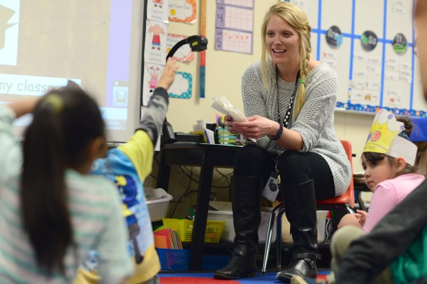 Jordan Crosby relax to her students in her Kindergarten class at Crawford Elementary on Feb. 17, 2016 in Aurora.