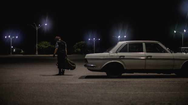 """A still from the 2016 independent film """"Dark Night,"""" loosely based on the Aurora theater shooting."""
