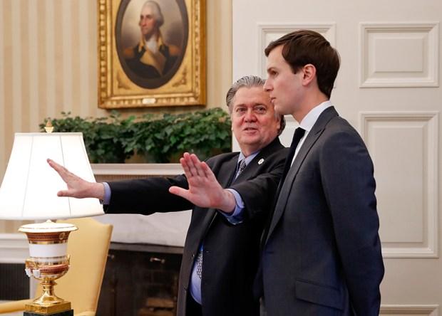 Political strategist Stephen Bannon, left, talks with White House senior adviser Jared Kushner in the Oval Office of the White House on Feb. 3.
