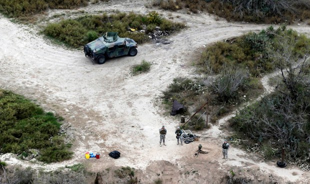 Members of the National Guard patrol along the Rio Grande at the Texas-Mexico border in Rio Grande City, Texas, on Feb. 24, 2015. The Associated Press reported last weekend that the Trump administration was considering a proposal to mobilize as many as 100,000 National Guard troops to round up undocumented immigrants. The White House denied the report.