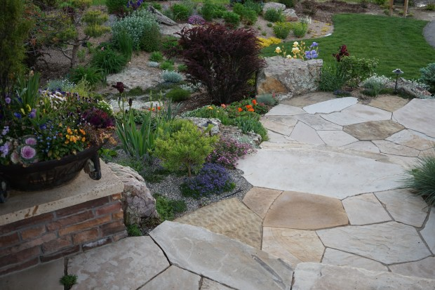 The front entry flagstone walkway and colorful xeric plantings in the front yard of Scott Deemer, owner of Outdoor Craftsmen. With a blank slate on his property, the landscaping professional brought in 3,000 plants, most of them xeric, and planned out five hydrozones on his land.