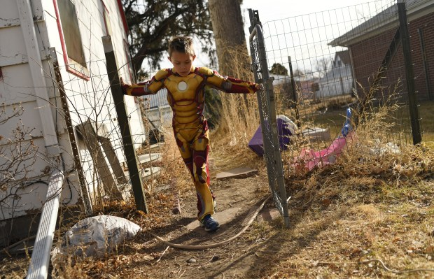 Chandler McClellan, 7, plays outside his