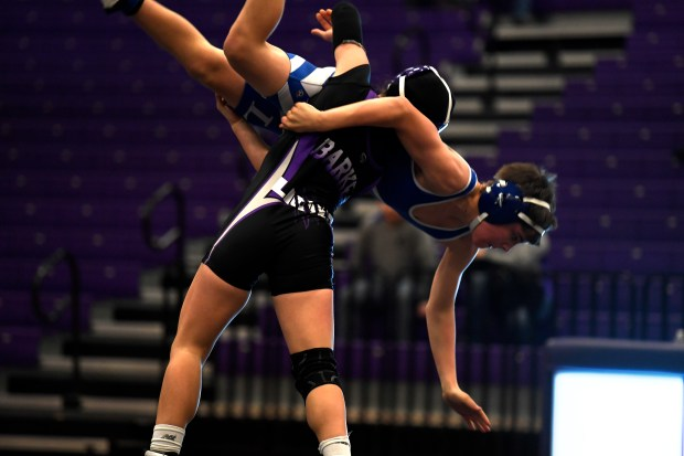 Mountain View's Kaley Barker lifts Eric Wagner from Longmont High School during their 113 pound match at Mountain View High School.
