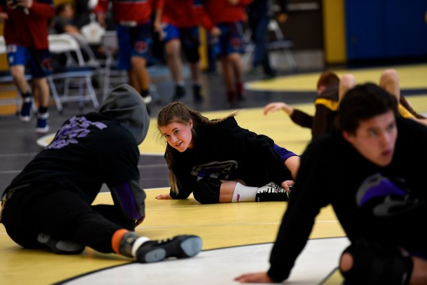 Kaley Barker, Mountain View High School's 113 pound wrestler, warms up during the 4A - Region 2 Wrestling Tournament