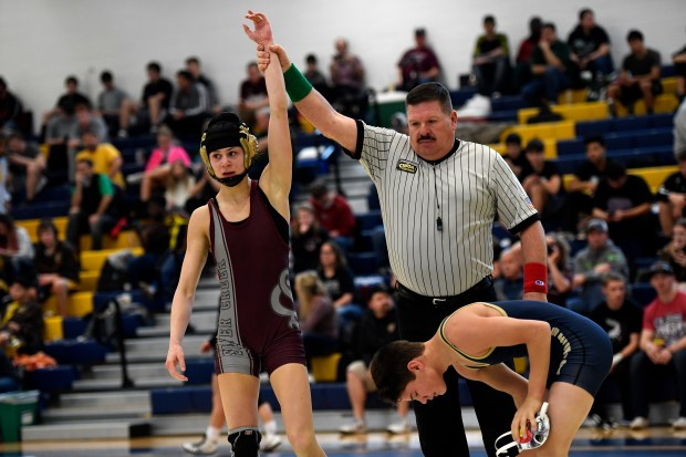 Silver Creek High School's Olivia Ioppolo, at 106 pounds looks to her corner after pinning Jonah Gardner of Frederick High School