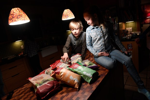 Charlie Reamer, 7, and his sister Olivia, 10, look at the assortment of new Jackson's Honest chips now available including Lime & Sea Salt tortilla chips and Maple and Cinnamon sweet potato chips on Jan. 10, 2017 in Crested Butte.
