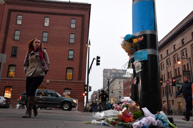 A makeshift memorial builds up around a pole at 16th and Wynkoop where a security officer was killed identified as Scott Von Lanken, 56, of Loveland. (Photo by John Leyba/The Denver Post)