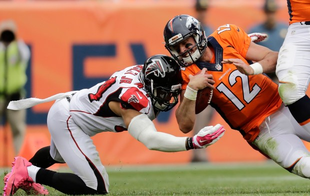 Denver Broncos quarterback Paxton Lynch (12) is hit by Atlanta Falcons outside linebacker Vic Beasley (44)