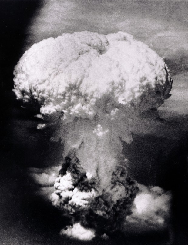 Aug. 9, 1945: A massive column of billowing smoke, thousands of feet high, mushrooms over the city of Nagasaki, Japan, after an atomic bomb was dropped by the United States. A B-29 plane delivered the blast killing approximately 70,000 people, with thousands dying later of radiation effects. The attack came three days after the U.S. dropped the world's first atomic bomb on the Japanese city of Hiroshima. The attacks brought about Japan's unconditional surrender.