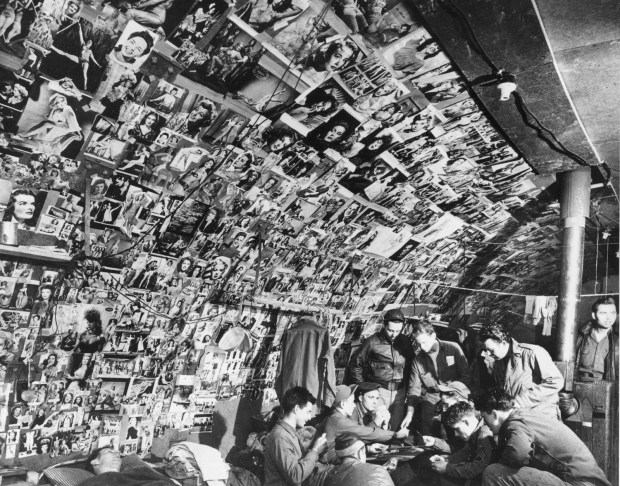 March 1944: Hundreds of pictures of pin-up girls adorn the entire wall of this bomber crew shack on Adak Island in the Aleutians in Alaska during World War II.