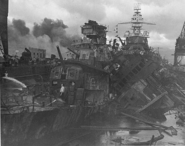 December 7, 1941: Heavy damage is seen on the battleships U.S.S. Casin and the U.S.S. Downes, stationed at Pearl Harbor after the Japanese attack on the Hawaiian island.