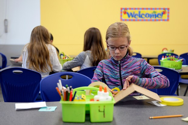 A student works on a project at Stargate School in Thornton, one of 238 charter schools in Colorado.