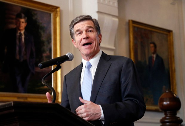 North Carolina Gov. Roy Cooper holds a press conference on Thursday in Raleigh to announce that he signed a HB142, a compromise replacement bill for HB2, that the N.C. General Assembly passed earlier in the day.
