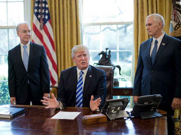 President Donald Trump, flanked by Health and Human Services Secretary Tom Price, left, and Vice President Mike Pence, right, speaks about health care on March 24 in the Oval Office.