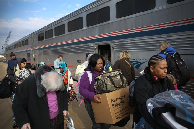Passengers walk along Amtrak's California Zephyr ...