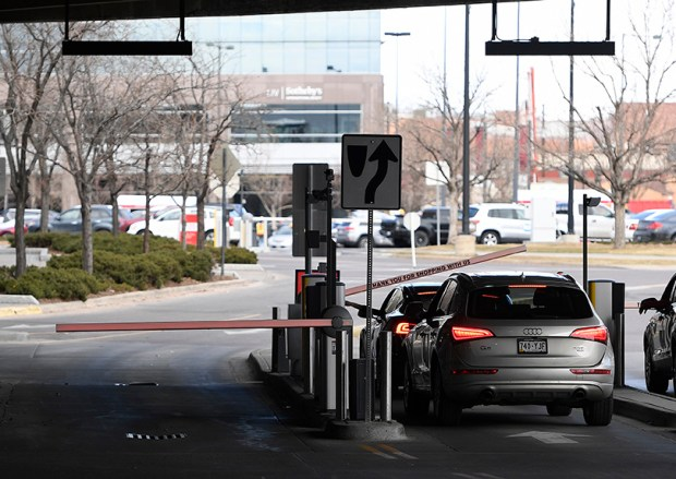 Shoppers stop to pay for parking as they leave the Cherry Creek Shopping Center on March 5. The mall's shop owners are saying the new paid parking is affecting foot traffic.