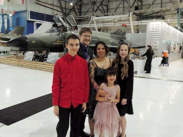 The three siblings -- Ethan, 16, Arianna, 13, and Sadie, 8 -- who were the recipients of personalized wishes from Make-A-Wish Colorado. They are pictured with their parents, Felima and Jesse.